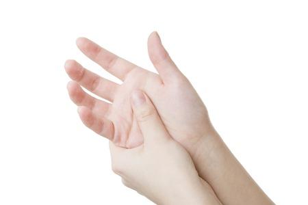 Massieren Sie die Handfläche. Pflege der weiblichen Händen isoliert auf weißem Hintergrund.