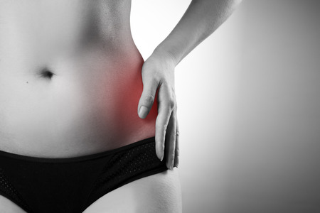 Pain in the left side. Pain in the woman body. Black and white photo with red dot