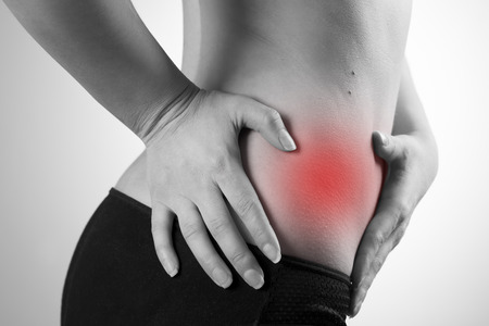 pancreatitis: Pain in the woman body. Attack of appendicitis. Black and white photo with red dot Stock Photo