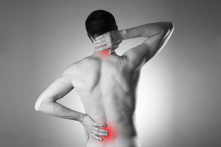Man with backache. Pain in the mans body. Black and white photo with red dots