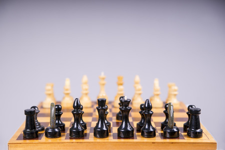 chess move: Concept with chess pieces on a wooden chess board. Selective focus