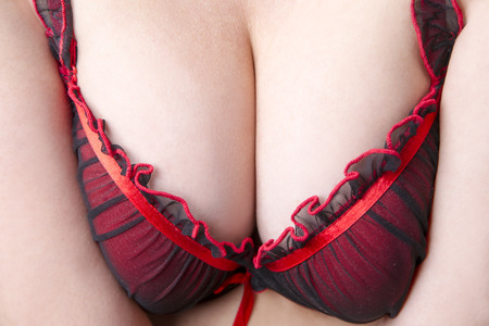 girl boobs: Big natural female breast in red bra close-up