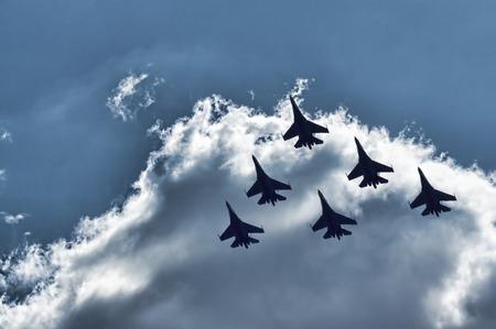 aerobatics: Group su-27 performing aerobatics at an airshow