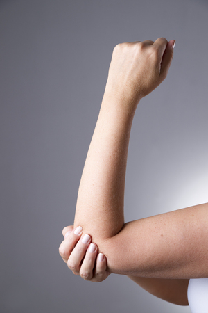 holding arm: Pain in the joints of the hands. Care of female hands