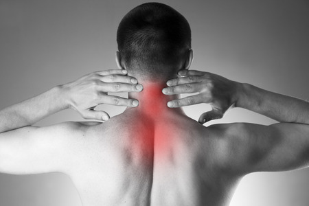 'head and shoulders': Pain in the neck. Man with backache. Pain in the mans body. Black and white photo with red dot