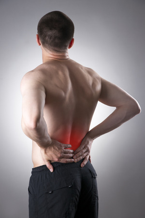 pyelonephritis: Man with backache. Pain in the human body on a gray background with red dot Stock Photo