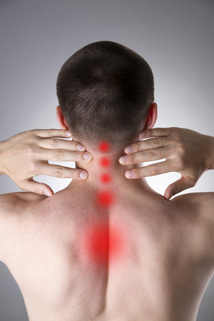 Pain in the neck. Man with backache. Pain in the mans body on a gray background with red dot