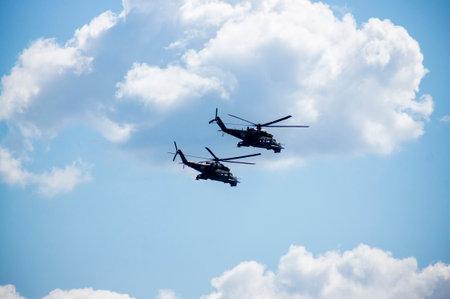 Group mi-24 performing aerobatics at an airshow Editorial