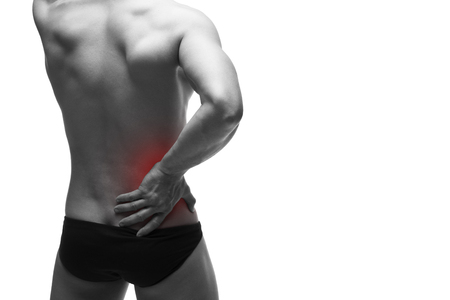 pyelonephritis: Kidney pain. Man with backache. Pain in the human body. Muscular male body. Isolated on white background. Black and white photo with red dot