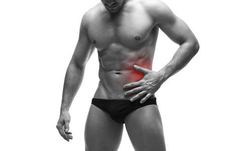 griping: Pain in the left side of the muscular male body. Isolated on white background. Black and white photo with red dot Stock Photo