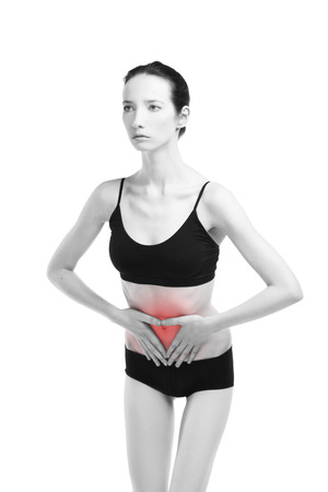 Woman with abdominal pain. Pain in the human body isolated on white background. Black and white photo with red dot