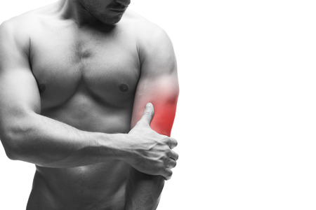 muscle pain: Pain in the elbow. Muscular male body with copy space. Isolated on white background with red dot. Black and white photography Stock Photo