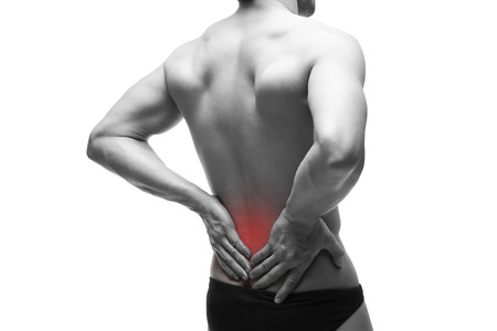 pyelonephritis: Man with backache. Pain in the human body. Muscular male body. Isolated on white background. Black and white photo with red dot