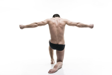 male arm: Handsome muscular bodybuilder posing on white background. Isolated studio shot. Sexy male body
