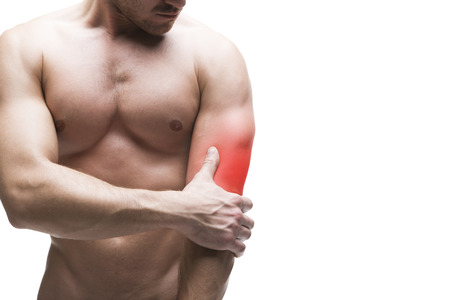 enhanced healthy: Pain in the elbow. Muscular male body with copy space. Isolated on white background with red dot Stock Photo