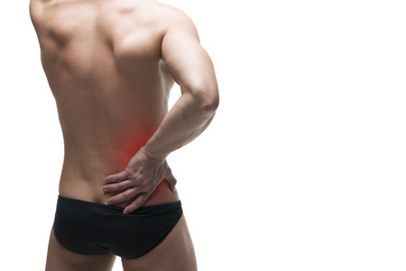 pyelonephritis: Kidney pain. Man with backache. Pain in the human body. Muscular male body. Isolated on white background with red dot