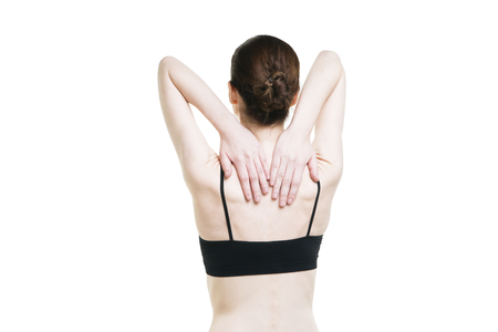 Woman with backache. Pain in the human body isolated on white background. Slim female body