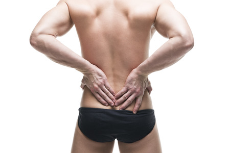 shoulder inflammation: Man with backache. Pain in the human body. Muscular male body. Isolated on white background. Middle part of the body