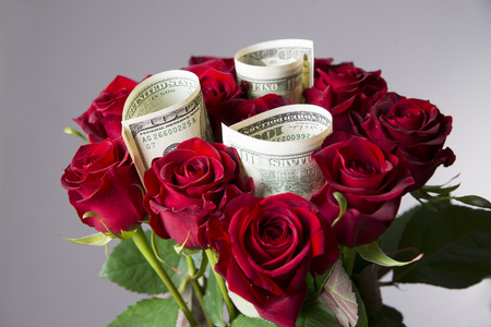 birthday suit: Bouquet of red roses on a gray background. Present at the International Womens Day Stock Photo