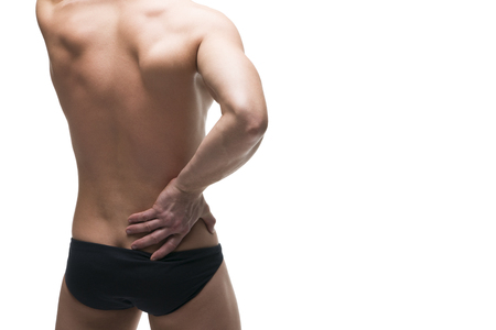 pyelonephritis: Kidney pain. Man with backache. Pain in the human body. Muscular male body. Isolated on white background. Middle part of the body