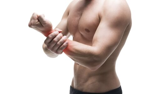 enhanced healthy: Pain in the hand. Muscular male body. Handsome bodybuilder posing in studio. Isolated on white background with red dot. Middle part of the body