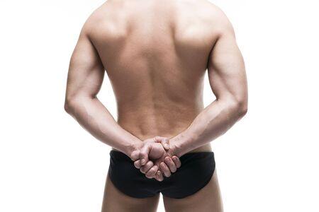 dorsi: Handsome muscular bodybuilder posing on white background. Isolated studio shot. Sexy male body