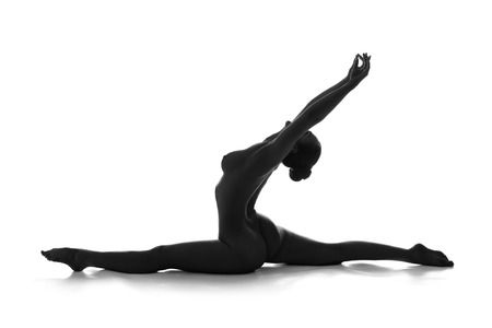 Nude yoga. Artistic photos of beautiful sexy body of young woman with perfect figure. Hanumanasana pose or splits. Isolated on white background. Studio shot Archivio Fotografico