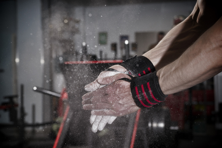 talc: Athlete uses talc in the gym. Toning image