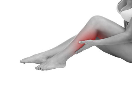 calf pain: Pain in the calf muscle of the woman, massage of female feet, ache in the human body isolated on white background with red dot
