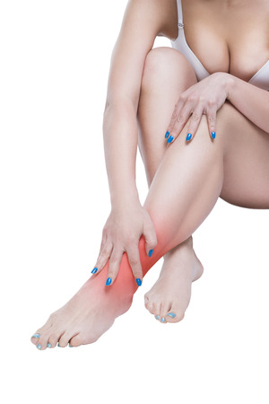 callus: Woman with pain in the joint, massage of female feet, ache in the human body isolated on white background with red dot Stock Photo