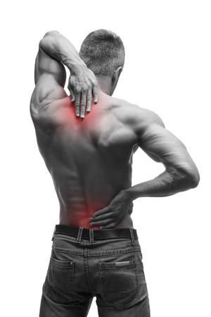 senior man on a neck pain: Middle aged man with back pain, muscular male body, studio isolated shot on white background with red dot, black and white photography