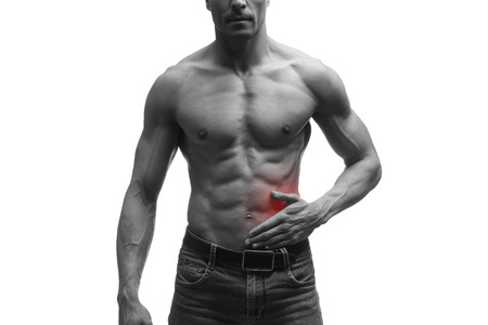 griping: Attack of appendicitis, pain in left side of muscular male body, isolated on white background, black and white photo with red dot Stock Photo