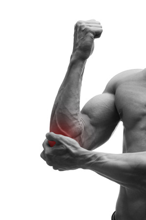 enhanced healthy: Pain in the elbow, muscular male body, isolated on white background with red dot, black and white photography
