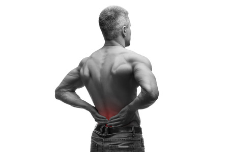 renal stone: Middle aged man with back pain, muscular male body, studio isolated shot on white background with red dot, black and white photography