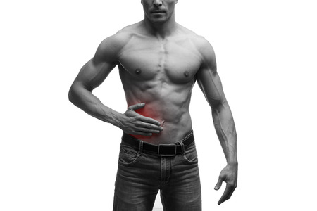 griping: Attack of appendicitis, pain in right side of muscular male body, isolated on white background, black and white photo with red dot Stock Photo