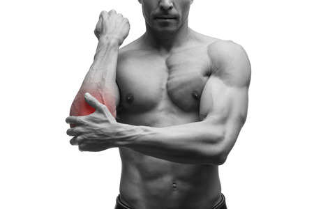 enhanced health: Pain in the elbow, muscular male body, isolated on white background with red dot, black and white photography