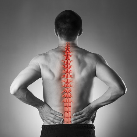 backpain: Spine pain, man with backache and ache in the neck, black and white photo with red backbone on gray background