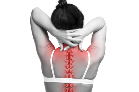 Spine pain, woman with backache and ache in the neck, black and white photo with red backbone on gray background Stock Photo