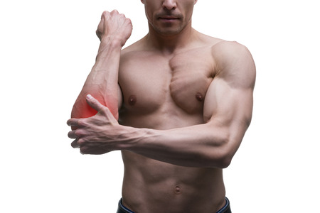 enhanced healthy: Pain in the elbow, muscular male body, isolated on white background with red dot
