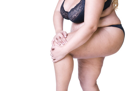 Plus size model in black lingerie, overweight female body, fat woman with thick thighs posing isolated on white background Stock Photo