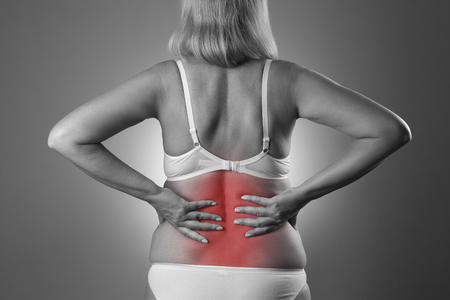 pyelonephritis: Back pain, kidney inflammation, ache in womans body, black and white photo with red spots