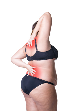Back and neck pain, fat woman with backache, overweight female body isolated on white background with red spots Stock Photo