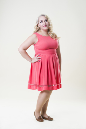 female sexuality: Plus size fashion model, fat woman on beige background, overweight female body, full length portrait