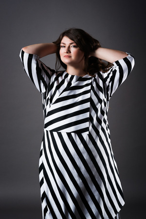 Plus Size Fashion Model In Striped Dress, Fat Woman On Gray Studio ...