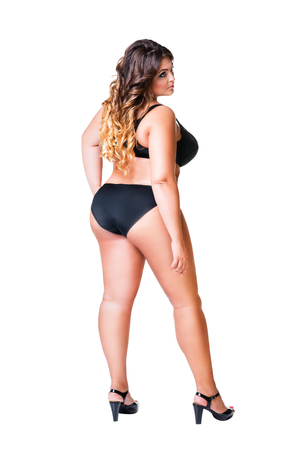 Plus size sexy model in black underwear, fat woman isolated on white background, overweight female body, full length portrait