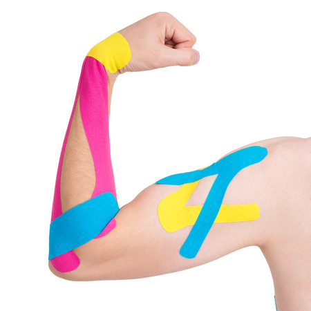 Kinesiology taping on human hand, isolated on white background Фото со стока