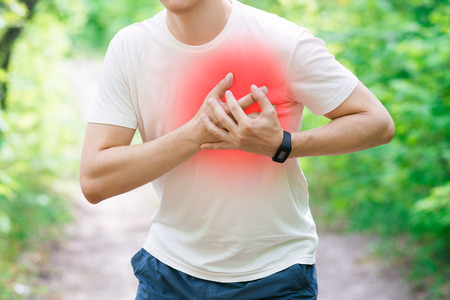 Man with heart attack, injury while running, trauma during workout, outdoors concept Zdjęcie Seryjne - 105873944