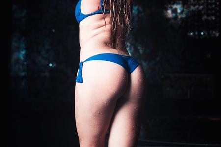 Wet women's buttocks in the shower, beautiful female feet