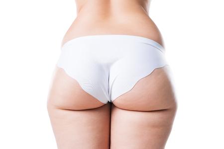 Mujer con sobrepeso con piernas y glúteos gordos, cuerpo femenino obesidad aislado sobre fondo blanco, Foto de estudio Foto de archivo
