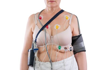 Woman with holter monitor device for daily monitoring of electrocardiogram and blood pressure isolated on white background